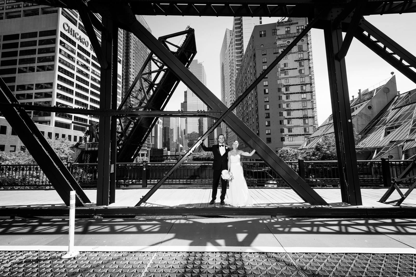 Black and White portrait of Bride and Groom on Kinzie Street Bridge in Chicago