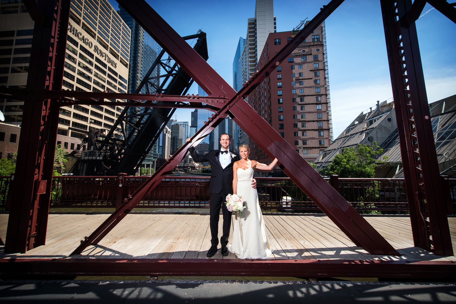 Colorful photo of Bride and Groom on Kinzie Street Bridge in Chicago