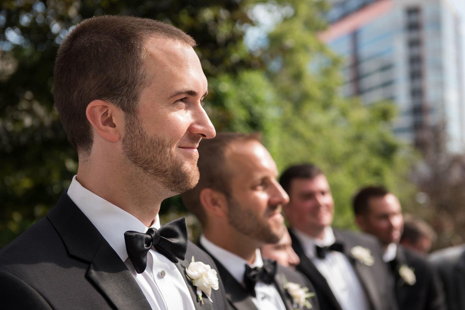 Groom watching bride come down the aisle