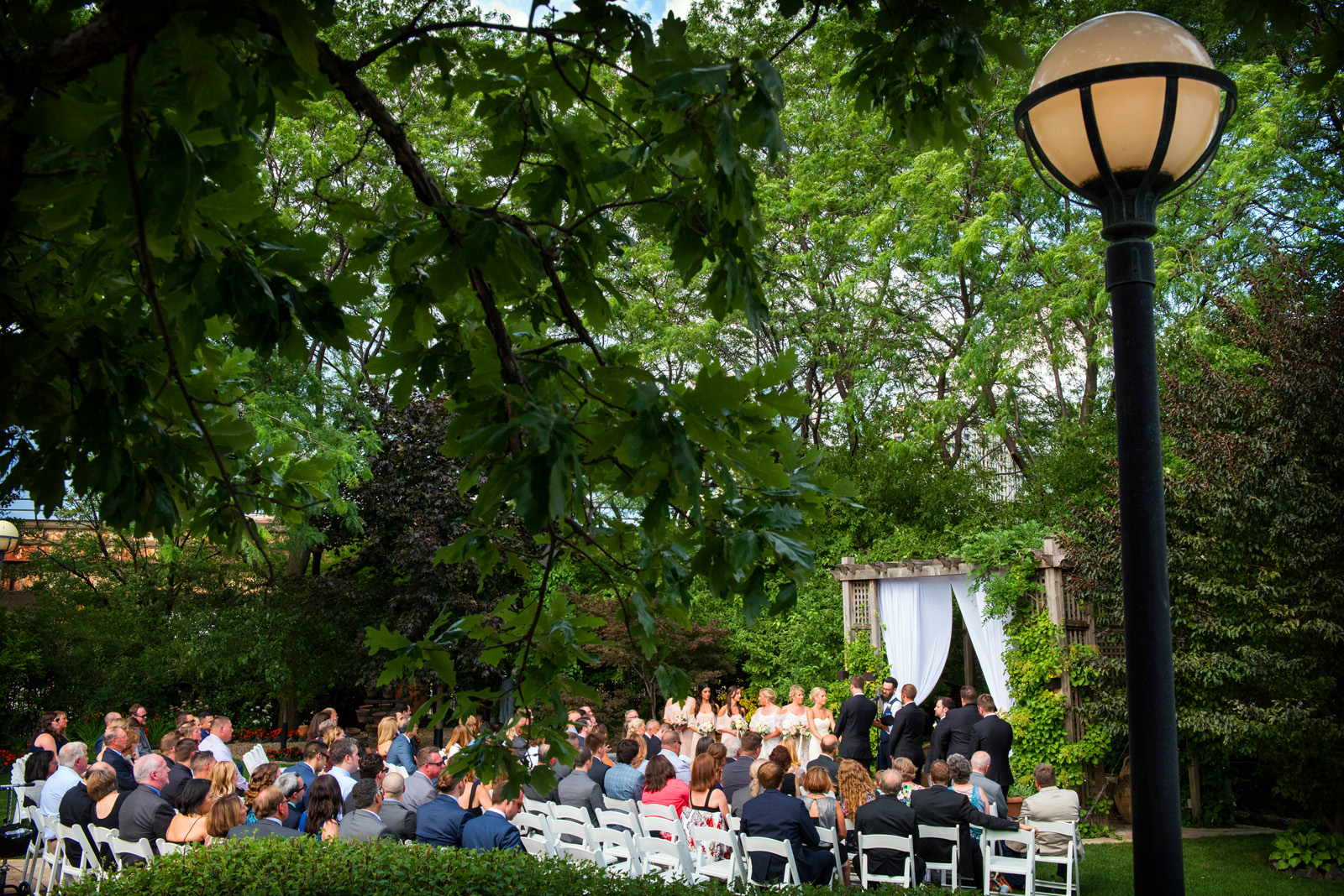 Outdoor wedding ceremony in garden at Galleria Marchetti in Chicago