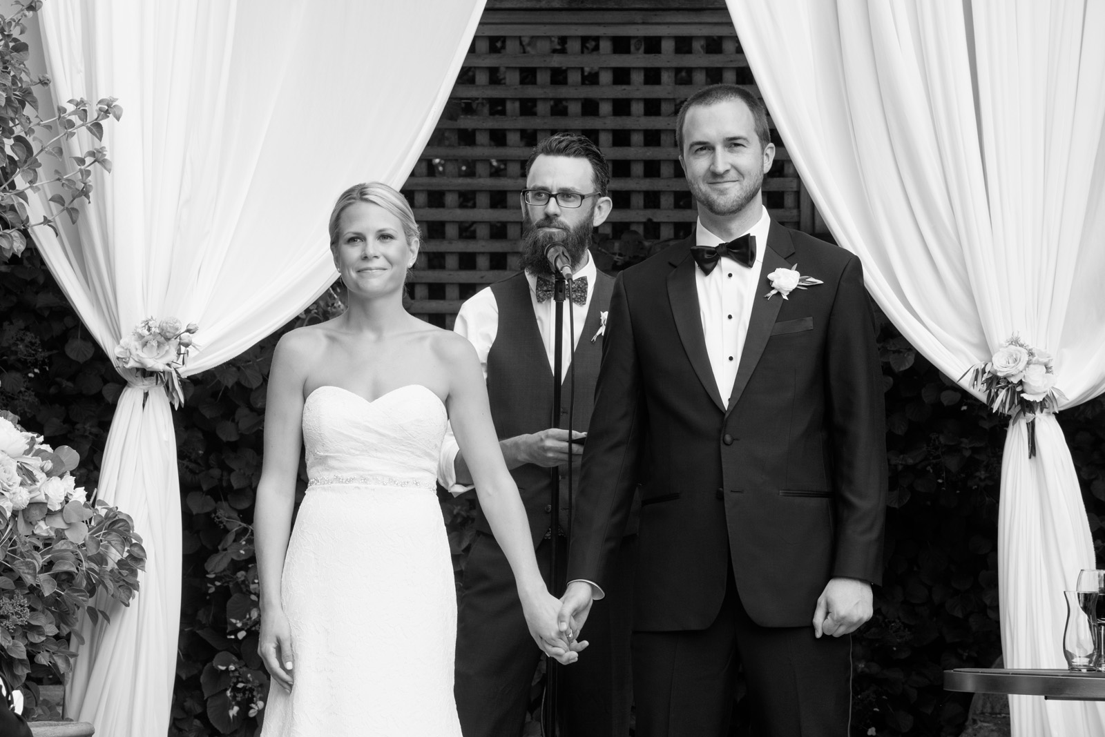 Black and White photo of Bride and Groom during wedding ceremony