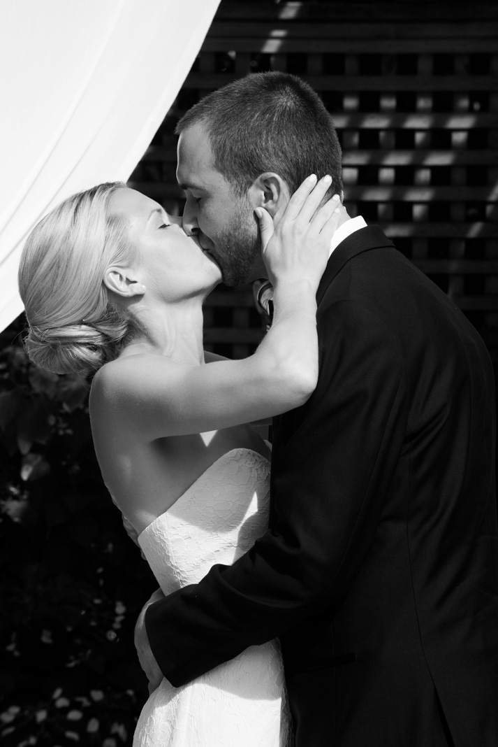 Bride and Groom's First Kiss in Black and White