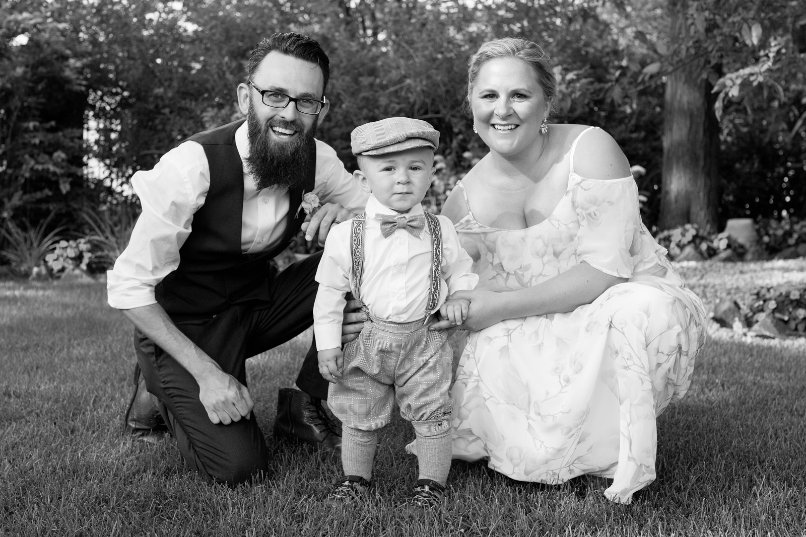 Cute wedding portrait of ring bearer in black and white