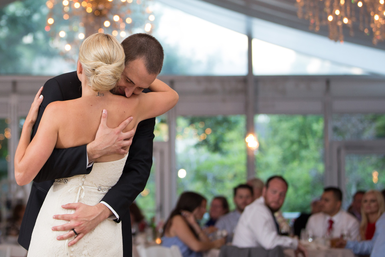 Groom hugging bride during First Dance