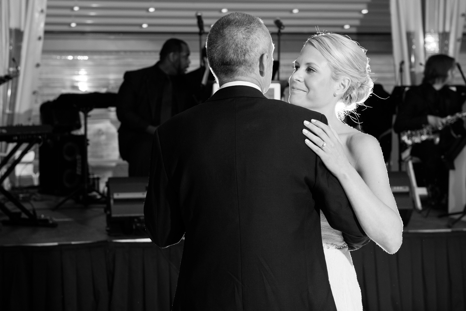 Touching Black and White photo of Bride dancing with her father
