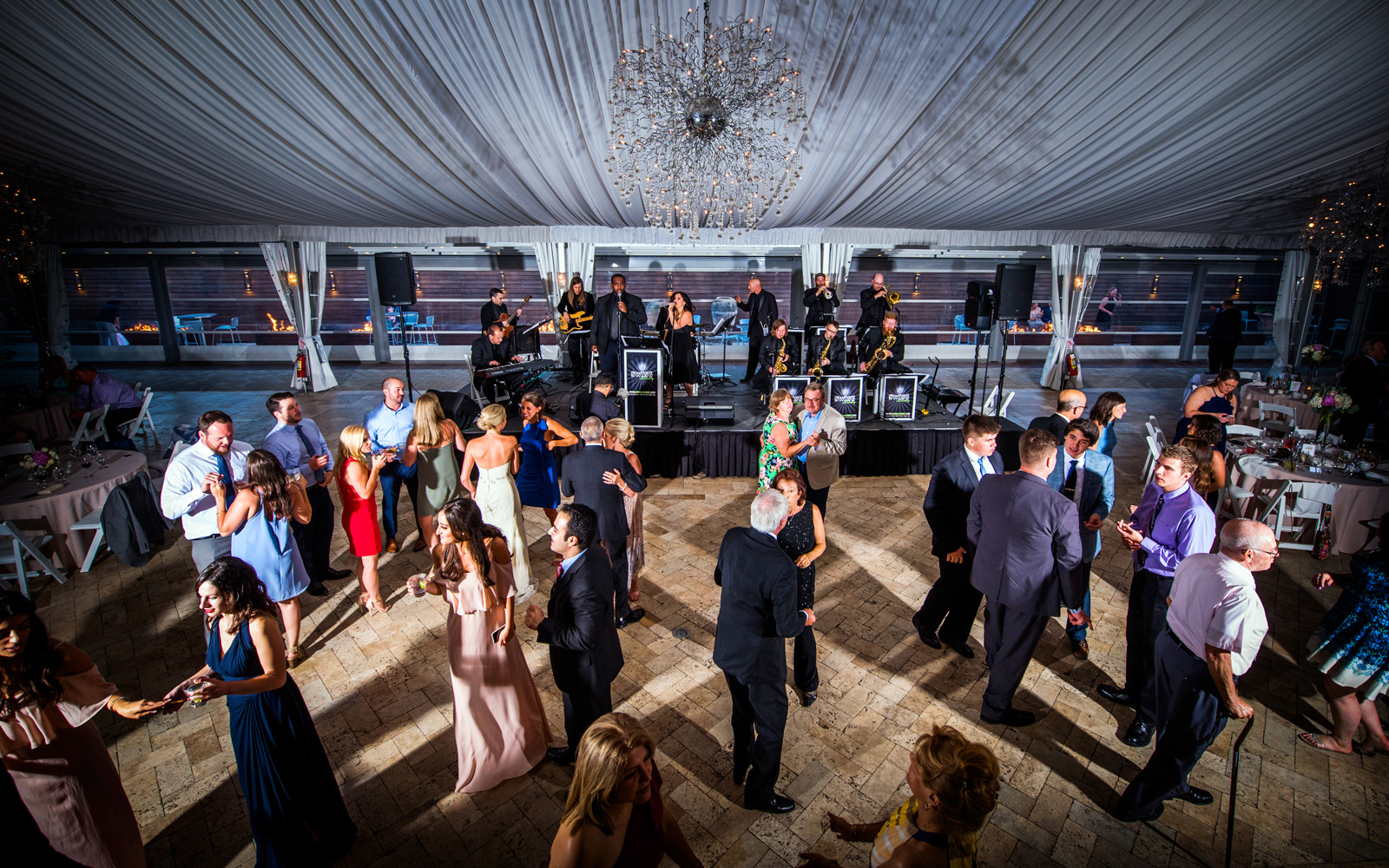 Colorful energetic photo of wedding band performing at a reception at Galleria Marchetti in Chicago