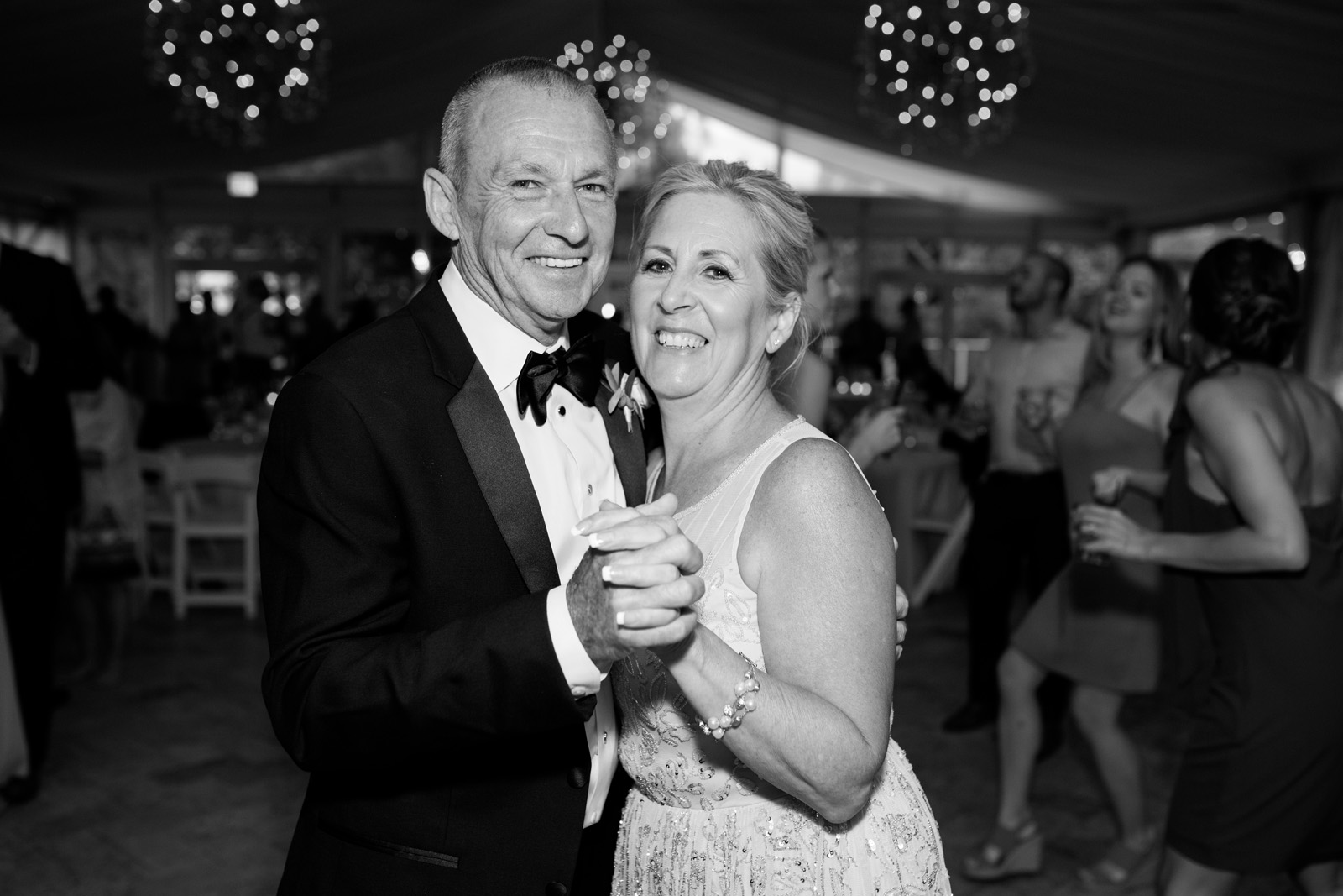 Parents of the Bride and Groom dancing at wedding reception