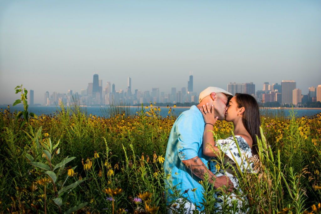 Couple kissing in field of sunflowers at the Magic Hedge in Chicago Montrose Avenue Beach