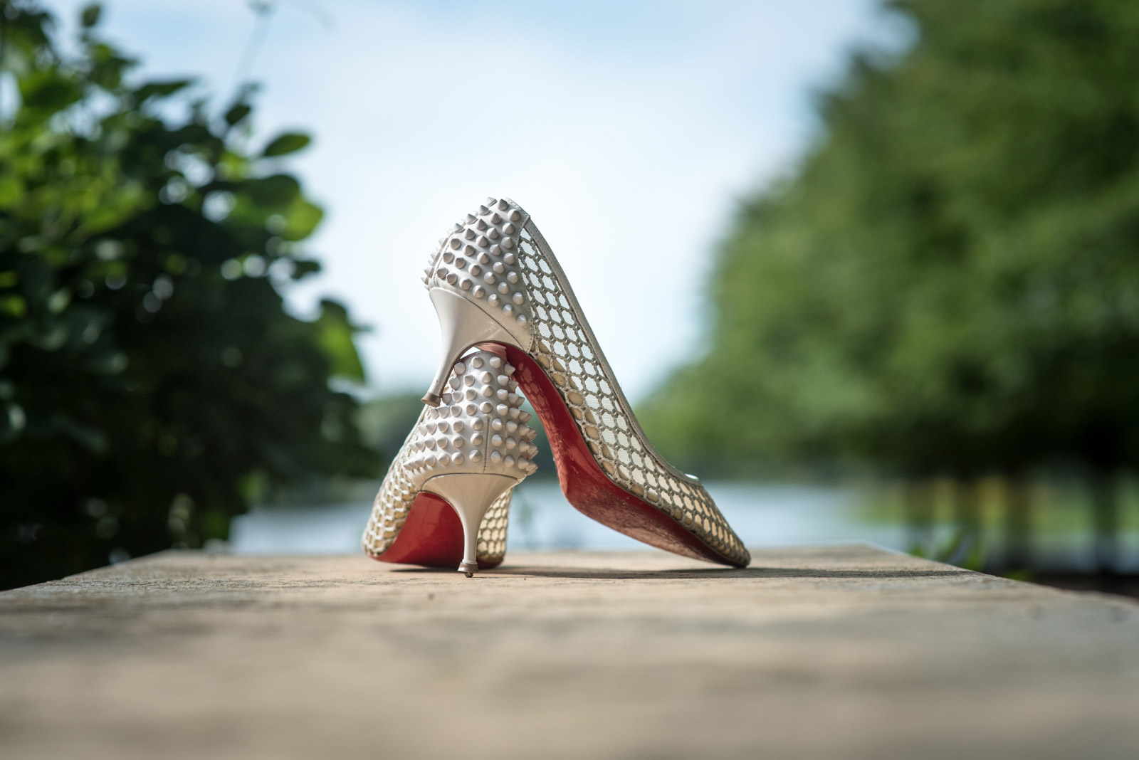 Pointy wedding shoes outdoors at Chicago Botanic Garden