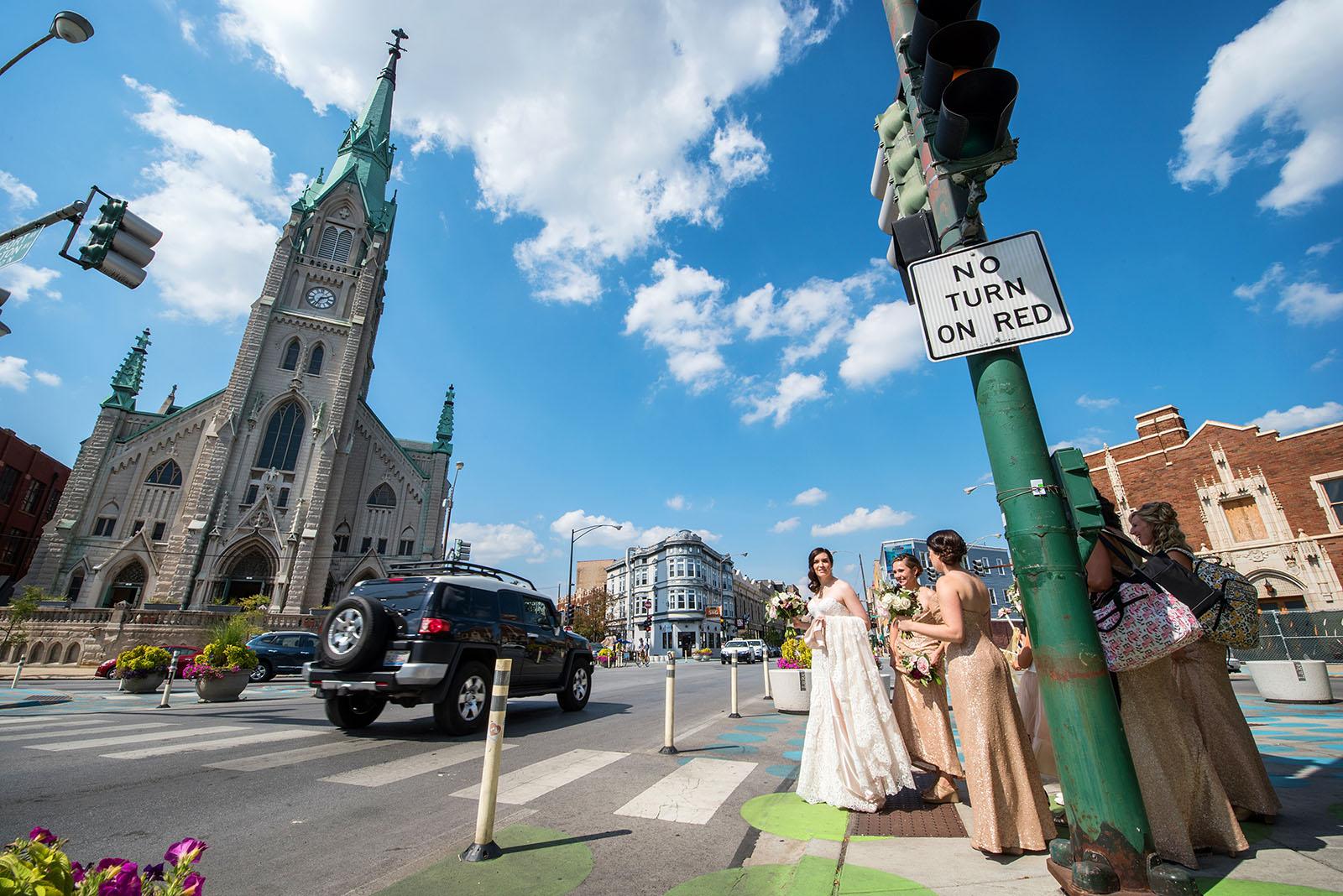 Bride Bridesmaids crossing street church