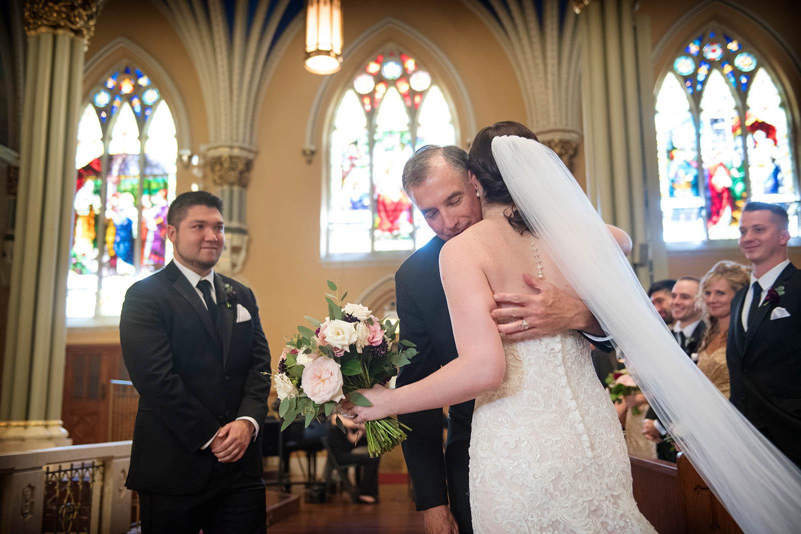 Bride hugs Dad St Alphonsus Church Wedding