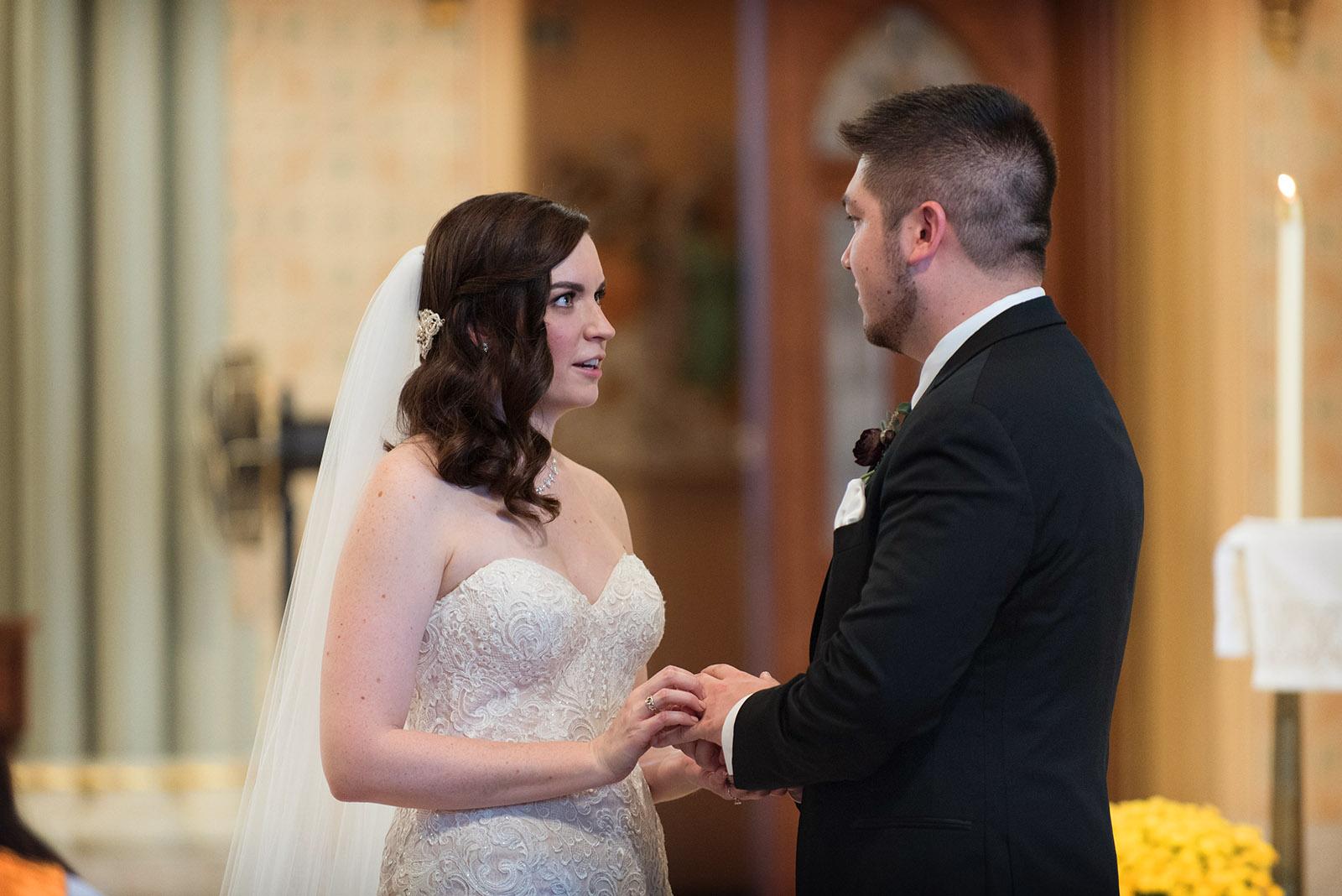 Bride Placing Ring Groom Finger