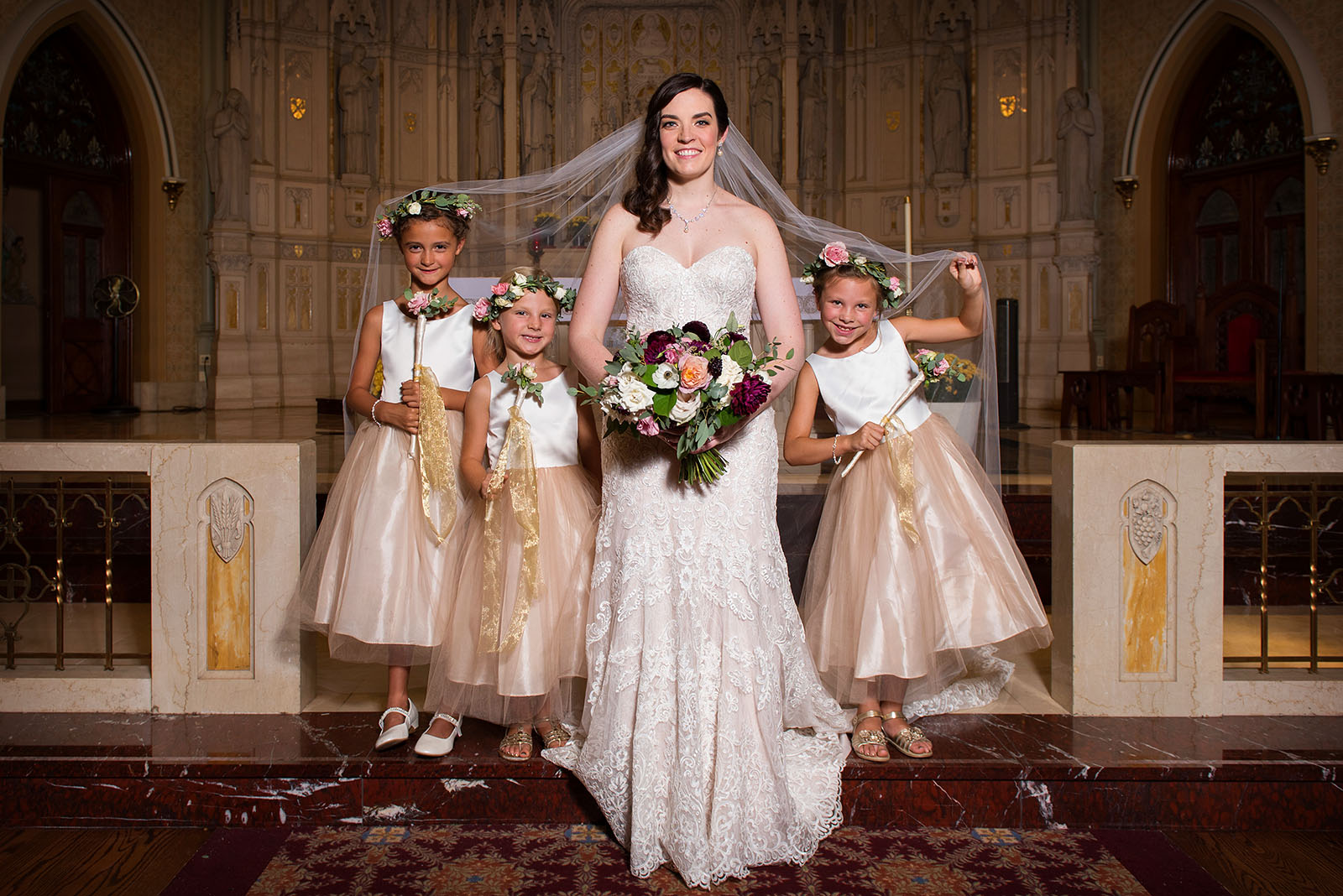 Flowergirls under bride veil