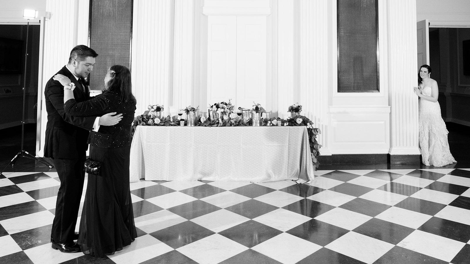 Bride watching Mother Groom Dancing