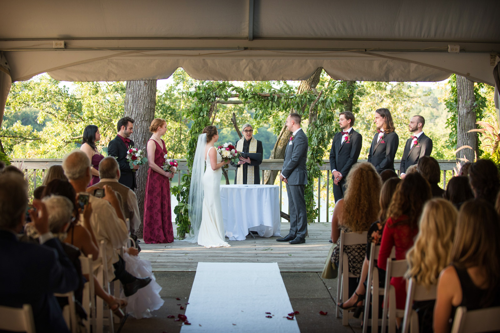 Wedding Ceremony with Bridal Party under tent at Eagle Ridge Resort