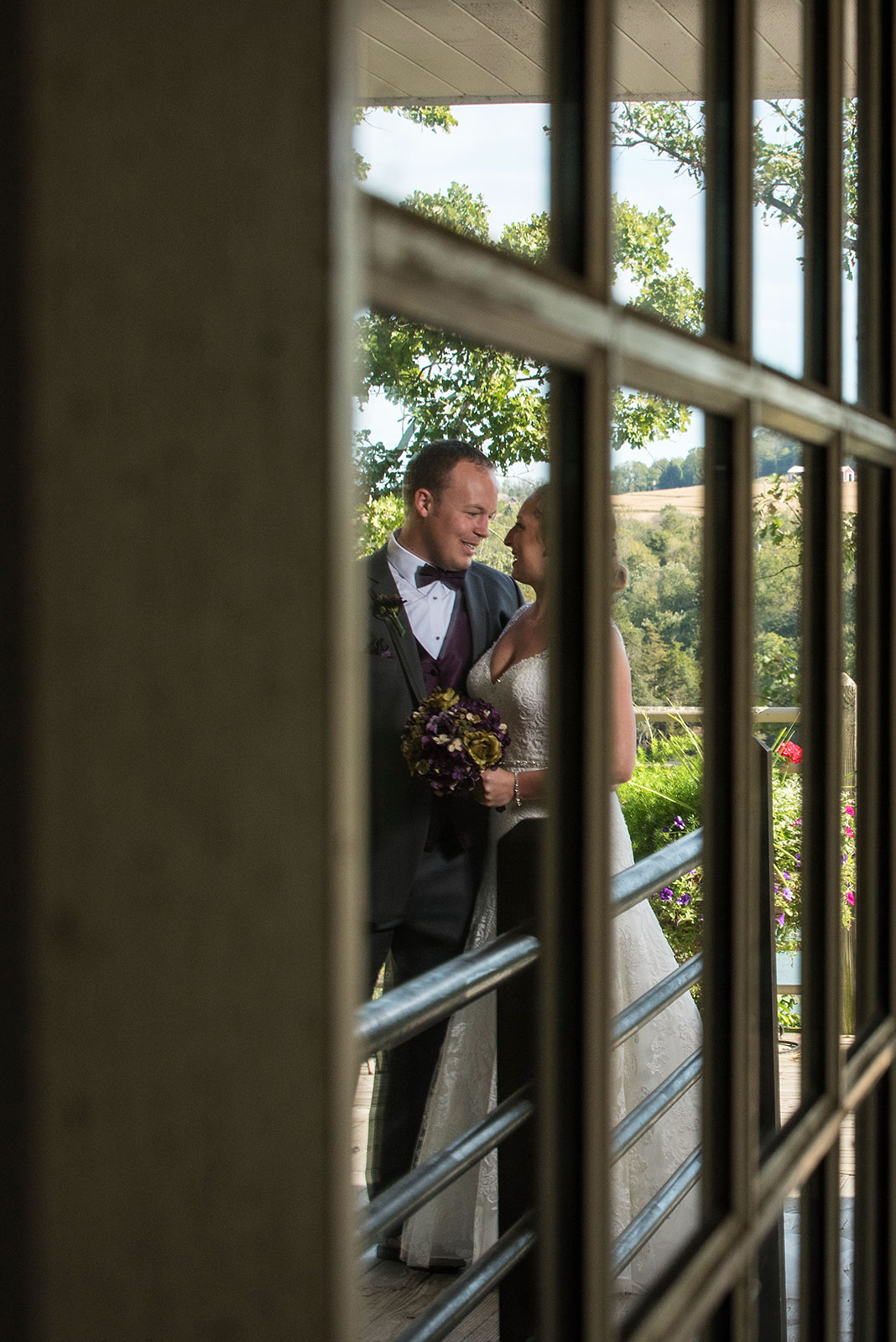 Bride Groom window reflection Eagle Ridge Resort Galena