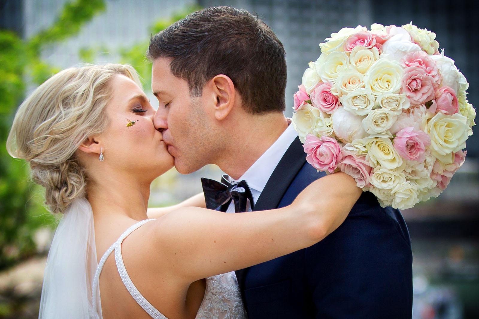Kissing newlyweds bee buzzing
