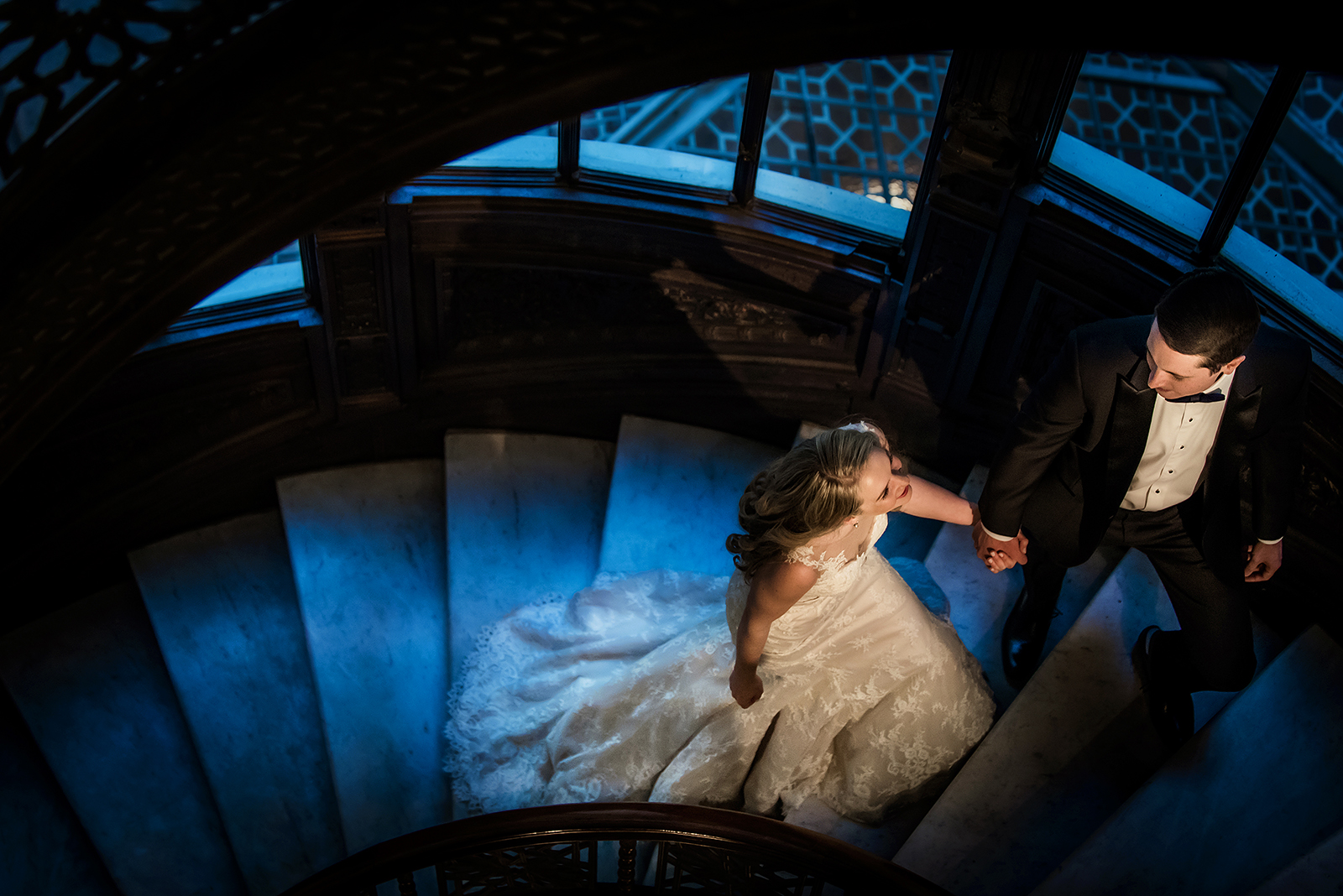 Oriel Staircase Hand holding Bride Groom