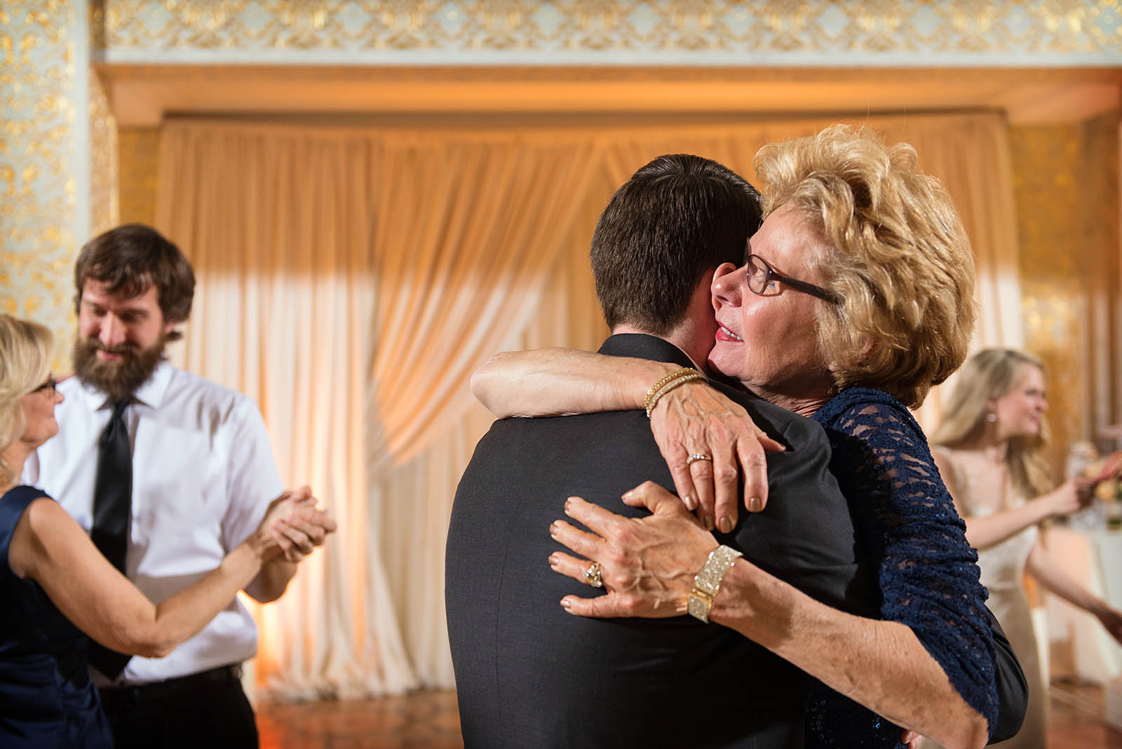Grooms Mother Hugs Groom During Dance