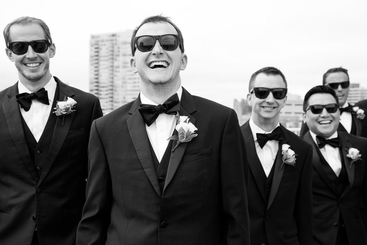 groomsmen laughter rooftop hotel orrington Evanston