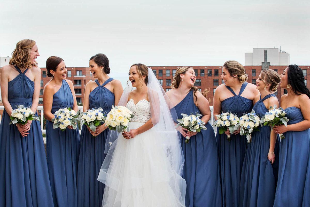 bride bridesmaids laughing rooftop hotel orrington Evanston