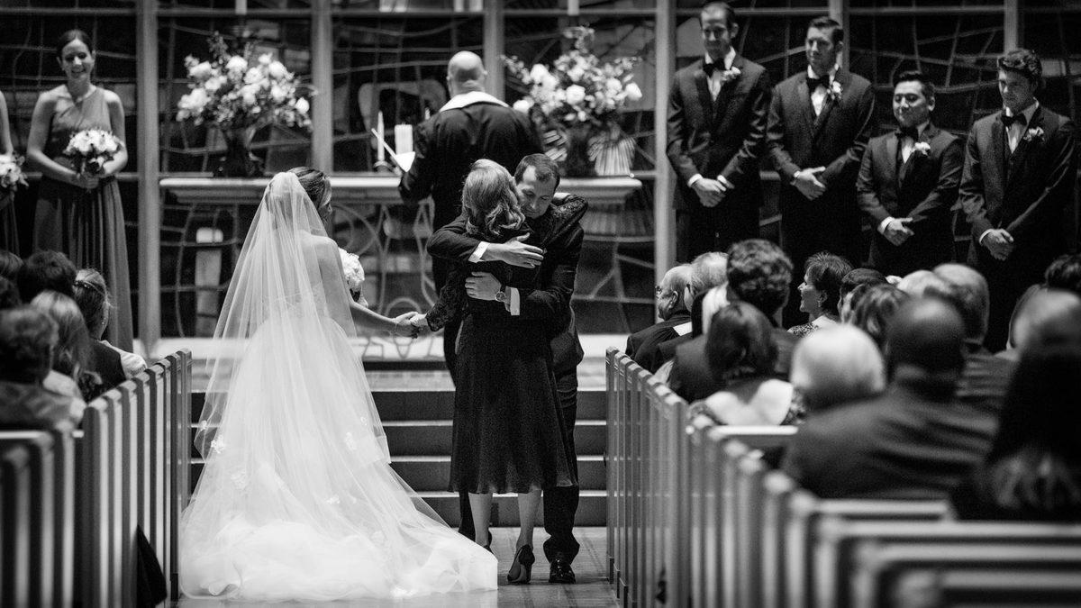 Mother Handing Off Bride to Groom